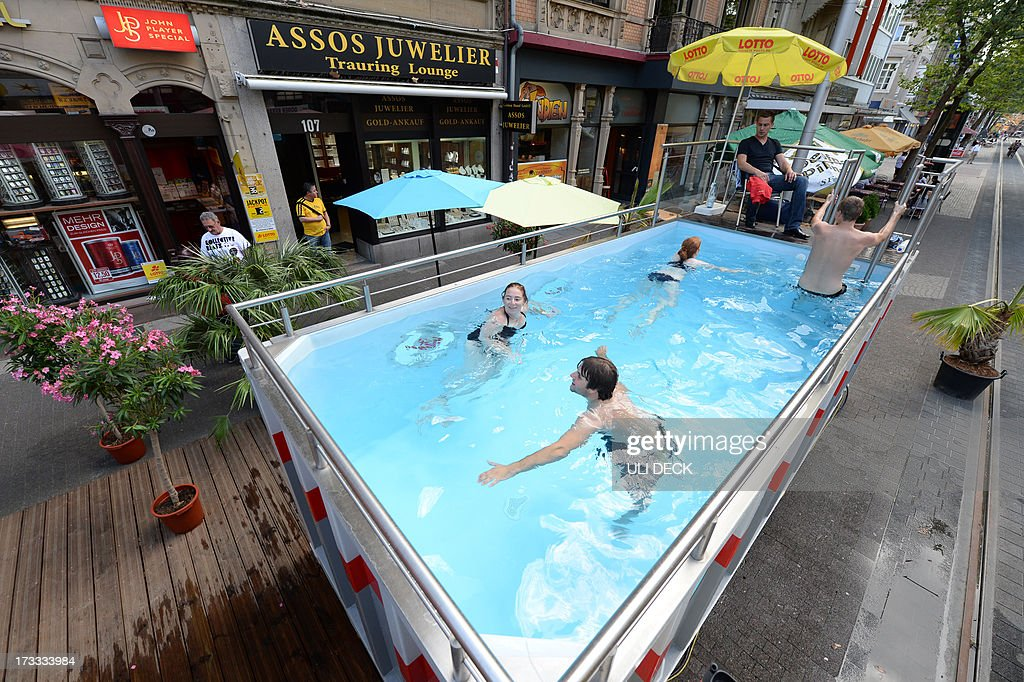 people go for a swim in a mobile container pool in downtown news photo getty images. Black Bedroom Furniture Sets. Home Design Ideas