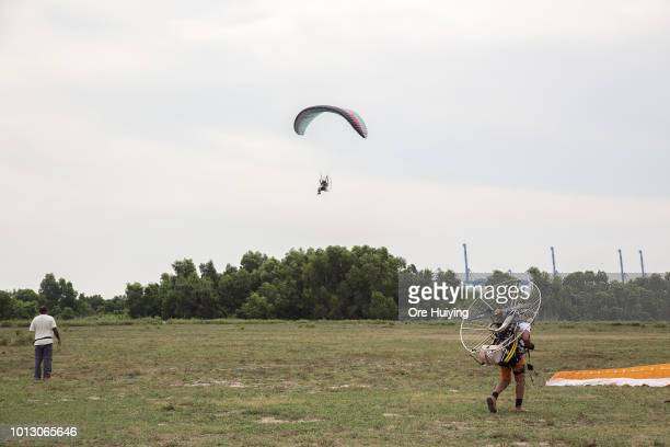 People go paragliding at the 234 acre land acquired by 1MDB fund in Pulah Indah on July 29 2018 in Selangor Malaysia Malaysia's former prime minister...