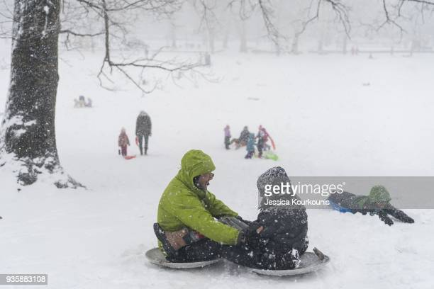 People go sledding in heavy snowfall on March 21 2018 in Philadelphia Pennsylvania The fourth nor'easter in three weeks has forced school closures...