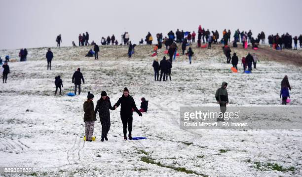 People go sledding on Primrose Hill in London as heavy snowfall across parts of the UK is causing widespread disruption closing roads and grounding...