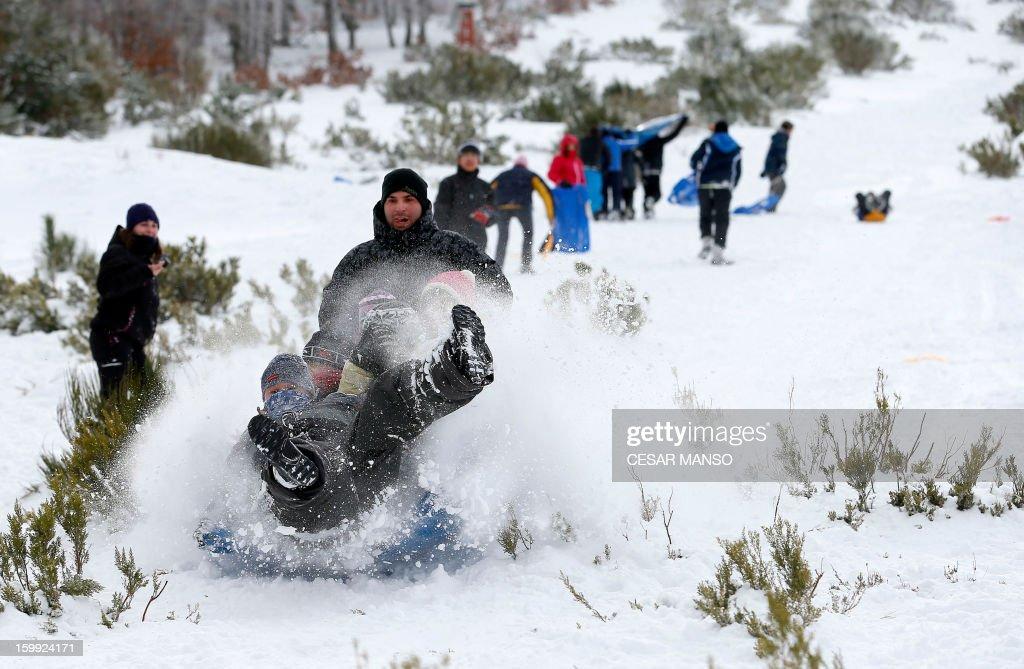 People go sledging after a snowfall in Pineda de la Sierra, near Burgos, on January 23, 2013.