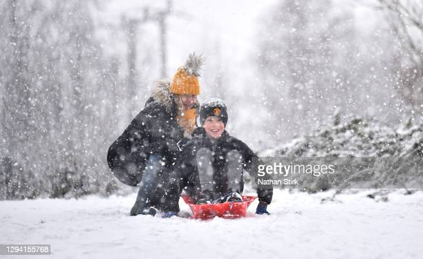 People go sledging in the snow around Silverdale Country Park on January 02, 2021 in Newcastle Under-Lyme, United Kingdom.