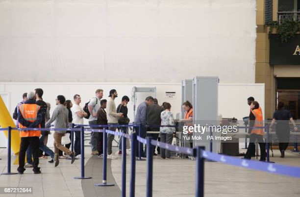 People go through a security check point in the foyer of the O2 Arena in London, the morning after a suicide bomber killed 22 people, including...