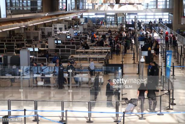 People go through security at Los Angeles International Airport in Los Angeles on October 29 2019