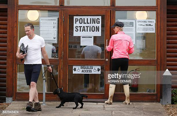 People go to vote in the EU referendum at a polling station in Little Milton on June 23 2016 Millions of Britons began voting today in a...