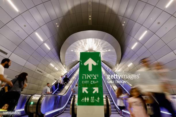 People go up and down escalators at the new train station in Jerusalem on September 25 2018 Israelis climbed aboard the country's new highspeed train...