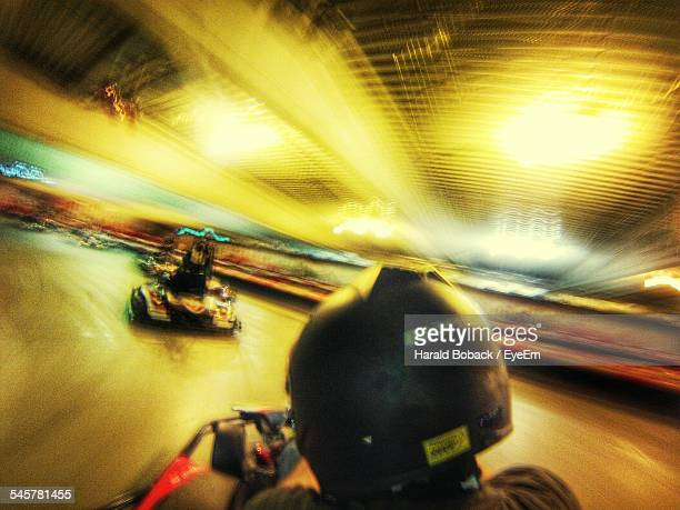 People Go-Carting On Racing Track