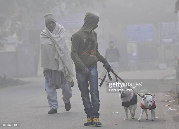 People going for the morning walk on foggy morning at Mayur Vihar on January 10 2014 in New Delhi India A cold chilly day greeted Delhiites today...