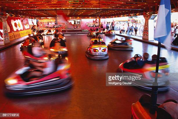 People going on dodgems, blurred motion
