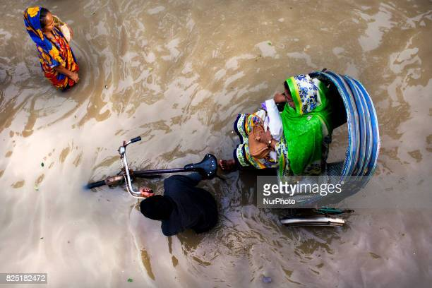 People going their destination in water logging area July 26 2017 Chittagong Bangladesh Every day the Chittagong city is facing unmatched...