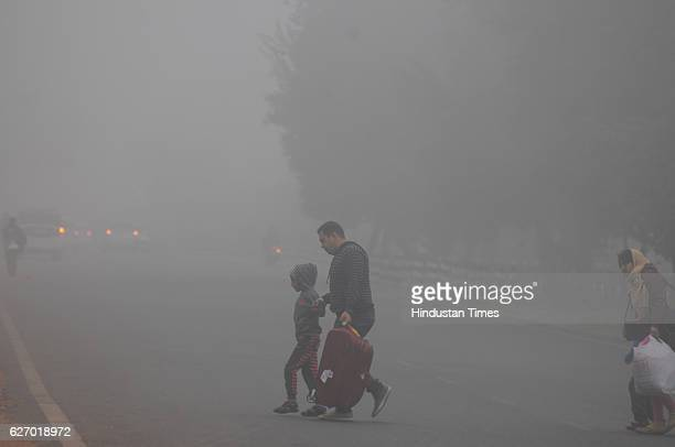 People going to home on a cold foggy morning on December1 2016 in Gurgaon India Traffic was moving slowly especially on the DelhiNoida and...