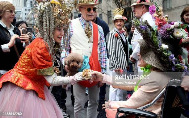 People greet each other in Midtown East for the annual Easter Parade on April 21 2019 in New York City Each year New Yorkers put on their most...
