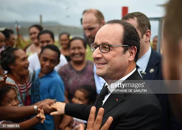 People greet French President Francois Hollande as he leaves Futuna island on February 22 during his twodays visit in the French overseas territory...