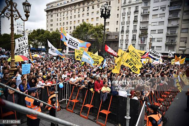 People greet president of Argentina Mauricio Macri as he leaves in a car after the inauguration of the 134th Period of Congress Ordinary Sessions on...