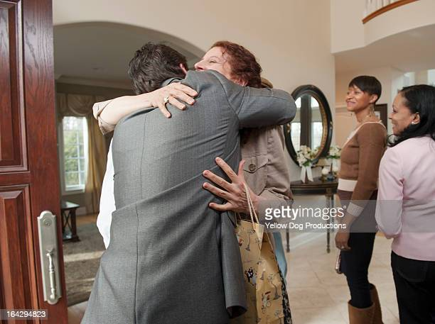 People greeting and embracing at a party