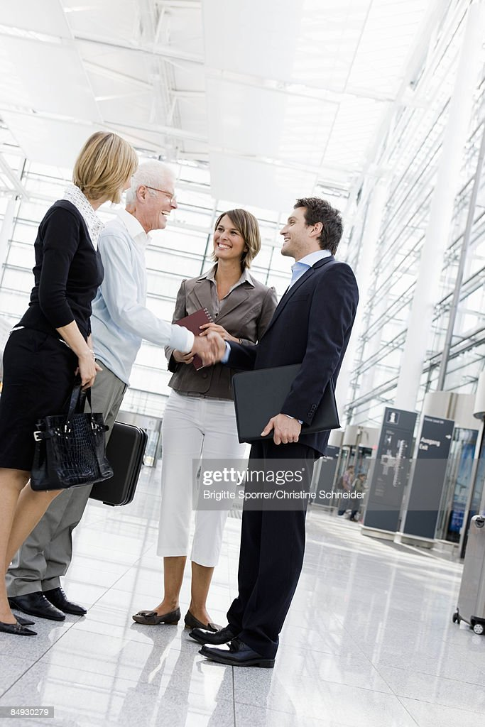 4 people greeting each other stock photo getty images 4 people greeting each other stock photo m4hsunfo
