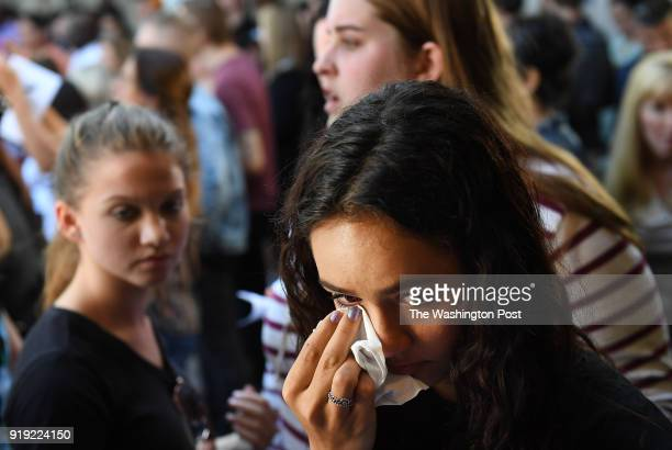 People grief before a community prayer vigil for Marjory Stoneman Douglas High School shooting at Parkridge Church on Thursday February 15 2018 in...