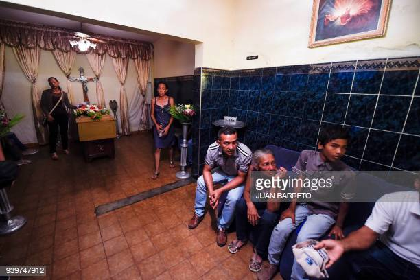 People grieve during the funeral of their relatives after a police holding cells caught fire in Valencia northern Carabobo state Venezuela on March...