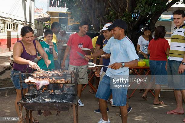 People grill meat and celebrate a birthday party