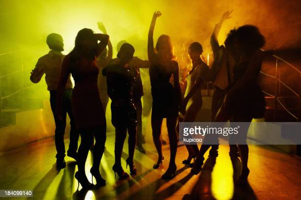 People grooving on dance floor at a night club