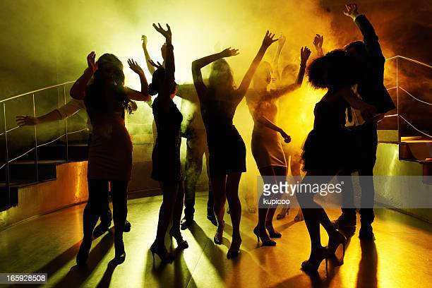 people grooving on the dance floor at a night club - dance floor stock pictures, royalty-free photos & images