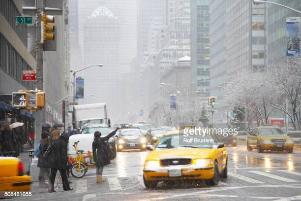 People hailing taxis on city street, New York City, New York, United States