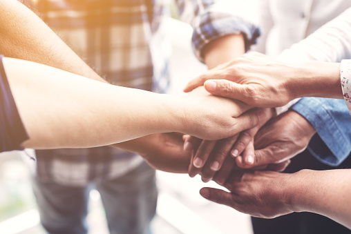 People hand assemble as a connection meeting teamwork concept. Group of people colleague assembly hands as a business or work achievement. Man and women touch each other hands. Teamwork conceptual. 1041144088