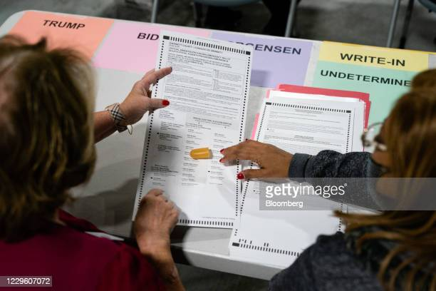 People hand count 2020 Presidential election ballots during an audit at the Gwinnett County Voter Registration office in Lawrenceville, Georgia,...