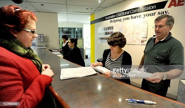 People hand in their enrolment forms at an Australian Electoral Commission office in Melbourne on July 19 the last day before the electoral rolls...
