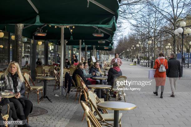 People hang out in a coffee shop in central Stockholm amid the new coronavirus pandemic in Stockholm Sweden April 10 2020 Swedish authorities have...