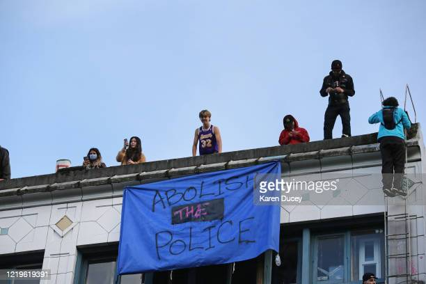 People hang out on rooftops in an area dubbed the Capitol Hill Autonomous Zone on June 12 2020 in Seattle Washington The area had been the site of...