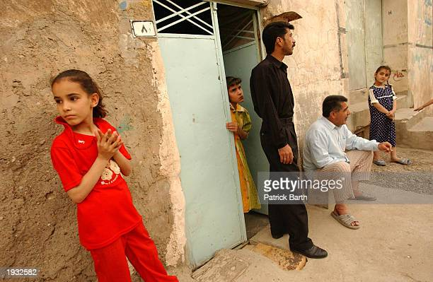 People hang out on the streets as the city returns to normal April 15, 2003 in Kirkuk, northern Iraq.