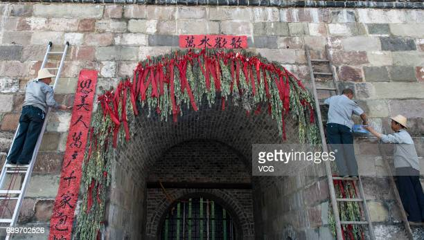 People hang up artemisia argyi to memorial Qu Yuan at Zigui County on May 28 2017 in Yichang Hubei Province of China People raced dragon boats made...