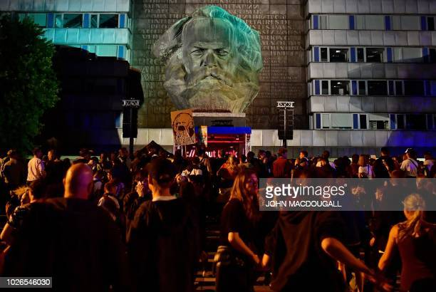 """People have a rave in front of the Karl-Marx statute after the """"We Are More"""" concert to say 'No' to the far right on September 3, 2018 in Chemnitz,..."""