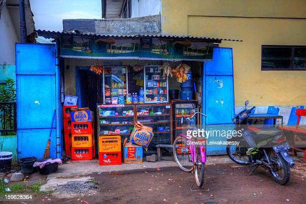 People have attached an additional shed-like structure to the front of their home, creating a small space to display the goods on sale. This is...