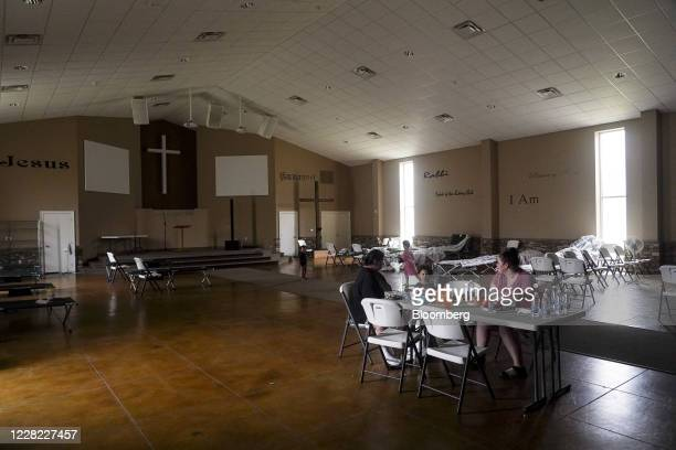 People have breakfast at an evacuation shelter run by the American Red Cross at Cornerstone Baptist Church after Hurricane Laura made landfall in...