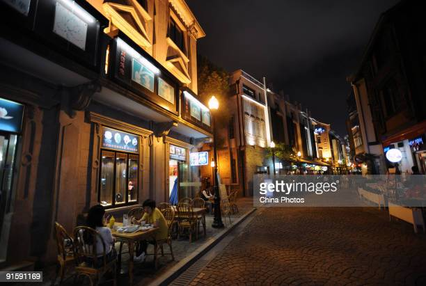 People have dinner at the ancient beach or 'Laowaitan' on October 8 2009 in Ningbo of Zhejiang Province China Ningbo a cultural and historic city of...