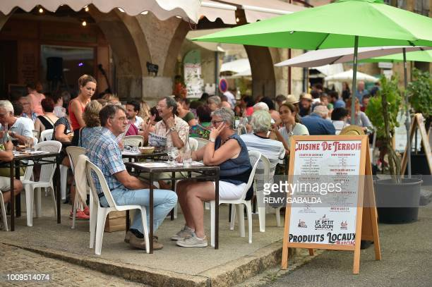 People have dinner in a restaurant's terrace on the main square of Marciac on July 31 during the 41st edition of the Marciac Jazz Festival