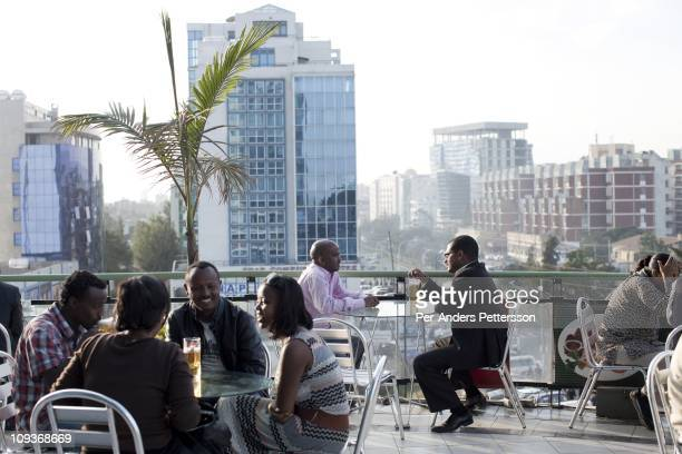 People have drinks at a popular rooftop cafe on November 16 2010 in the Friendship shopping mall in Addis Ababa Ethiopia Some people can afford to...