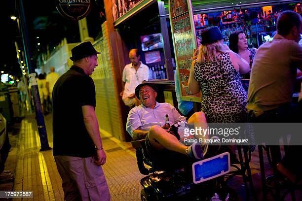 People have drinks outside a pub around the British Square on August 9 2013 in Benidorm Spain Benidorm is one of Europe's top package holiday...