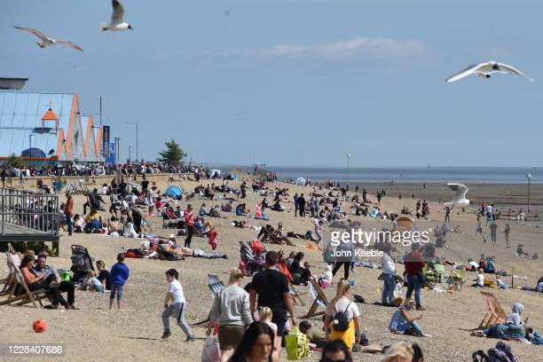 People have flocked to the beach to enjoy the sunshine and warm weather during the coronavirus covid19 pandemic on May 17 2020 in Southend on Sea...