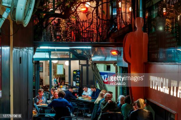 People have fun in the evening bars at Navigli District. Milan. Lombardy. Italy. Europe.
