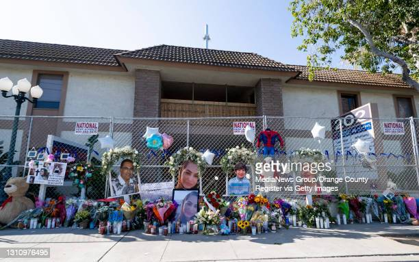 """People have left flowers and memories at a memorial to victims of a mass shooting in Orange, CA on Monday, April 5, 2021. """"nThe shooting, which..."""