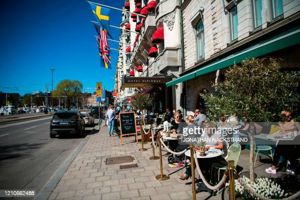 People have lunch at a restaurant in Stockholm on April 22 during the coronavirus COVID-19 pandemic.