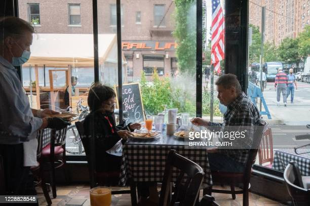 People have lunch at Chelsea Square Restaurant as New York City restaurants open for limited capacity indoor dining on October 1, 2020 in New York.