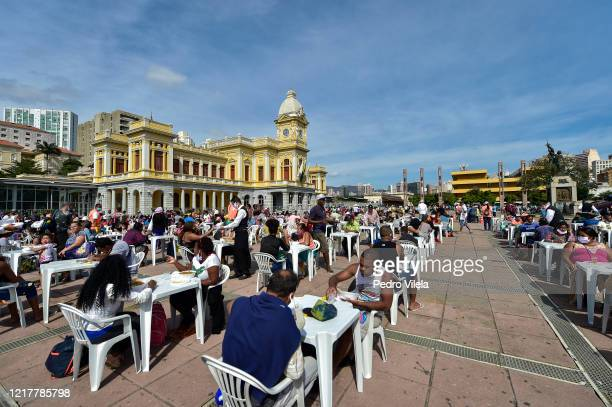 People have lunch at open air restaurant set up at Praça da Estação on June 5, 2020 in Belo Horizonte, Brazil. About 3000 meals are being distributed...