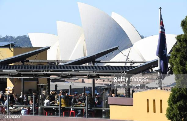 People having an afternoon beer on a rooftop bar in the warm winter sunshine on August 5 2018 in Sydney Australia Sydney has had 13 days of at least...