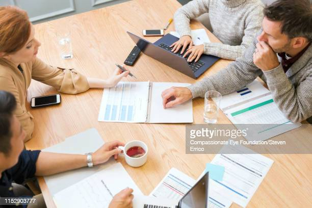 "people having business meeting in office - ""compassionate eye"" stock pictures, royalty-free photos & images"