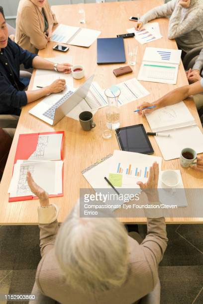 """people having business meeting in office - """"compassionate eye"""" stock pictures, royalty-free photos & images"""