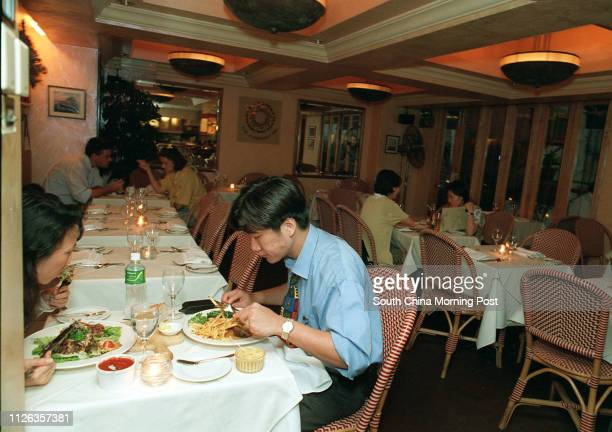 People having dinner at the American Pie in Lan Kwai Fong picture by Wan Kamyan June 21 1995